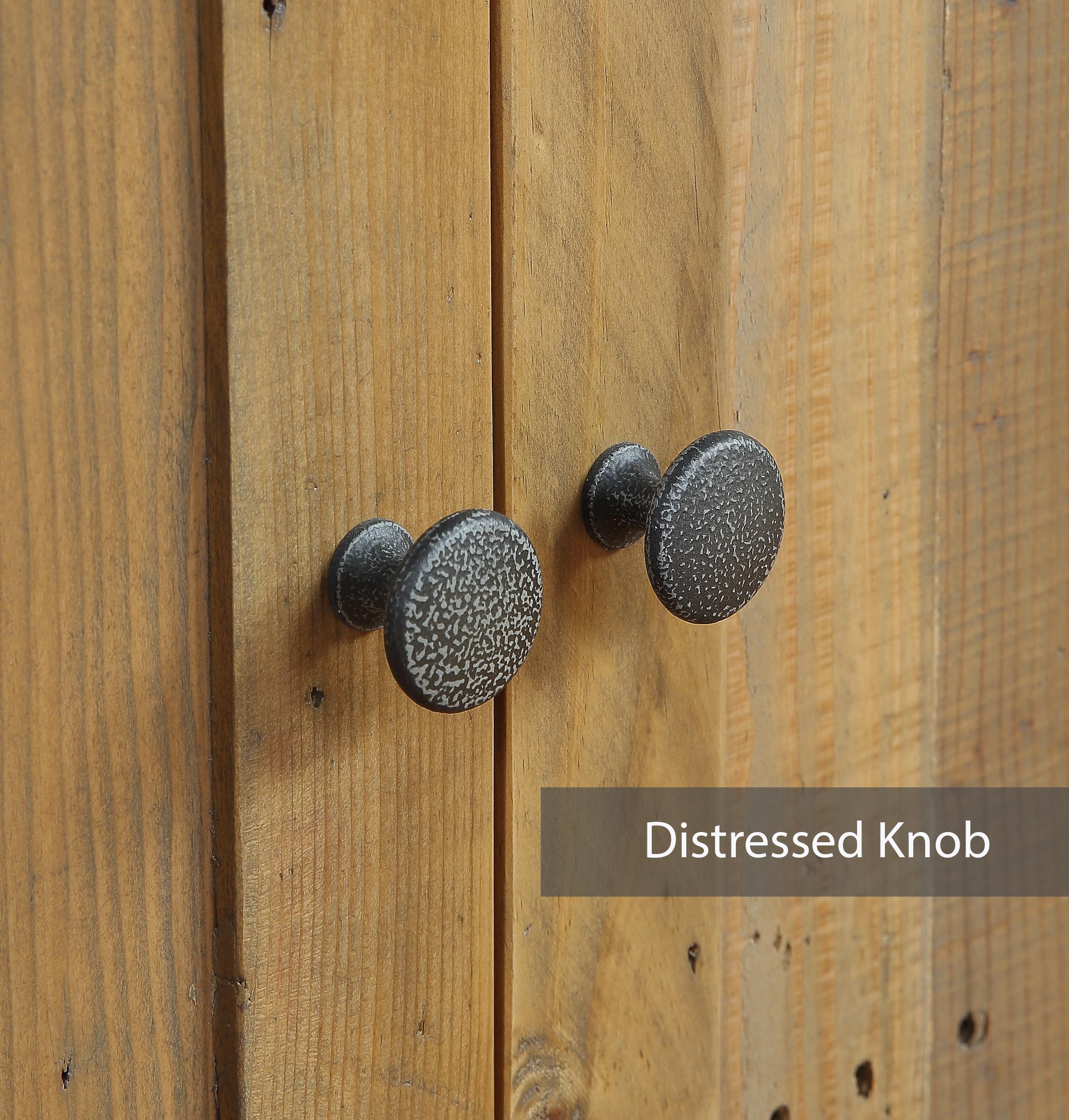 a pair of distressed cupboard door knobs
