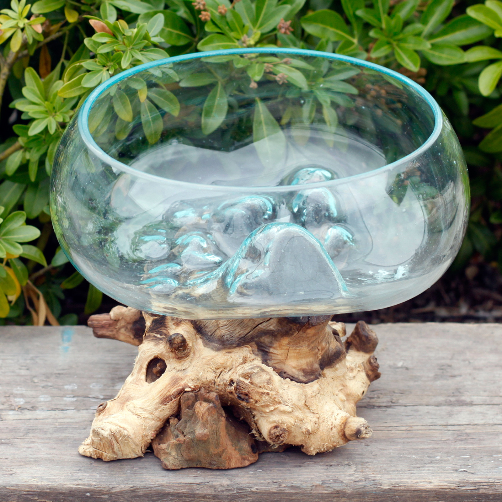 large open bowl made from molton glass on wood