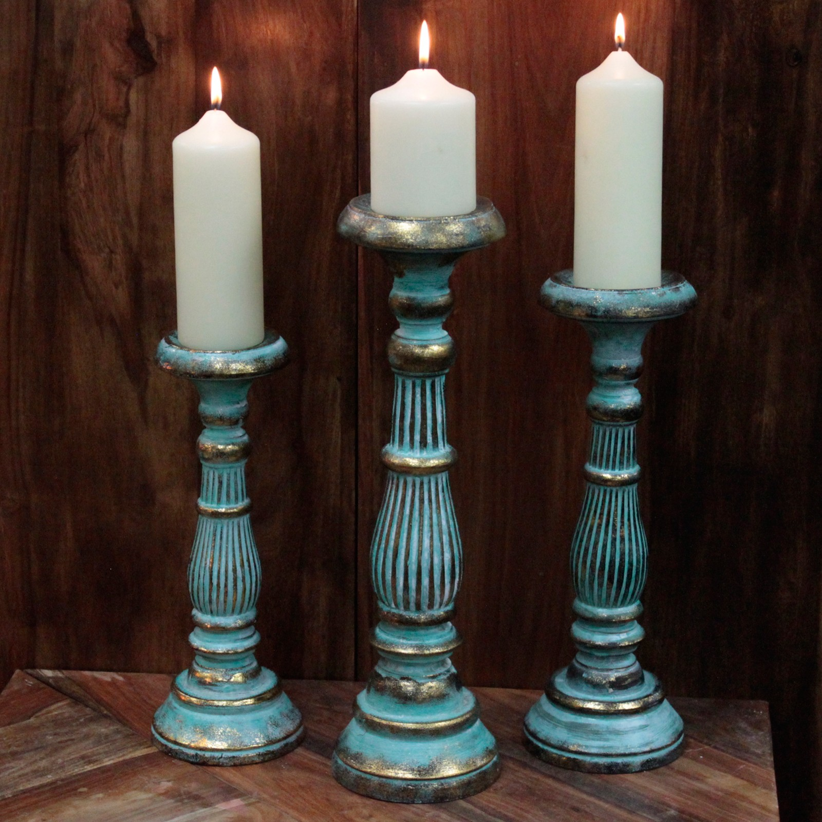 three turquoise and gold candles