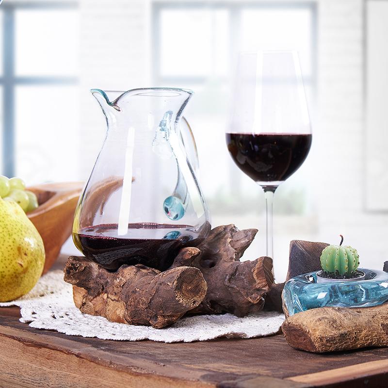 Molten glass on wood wine caraffe