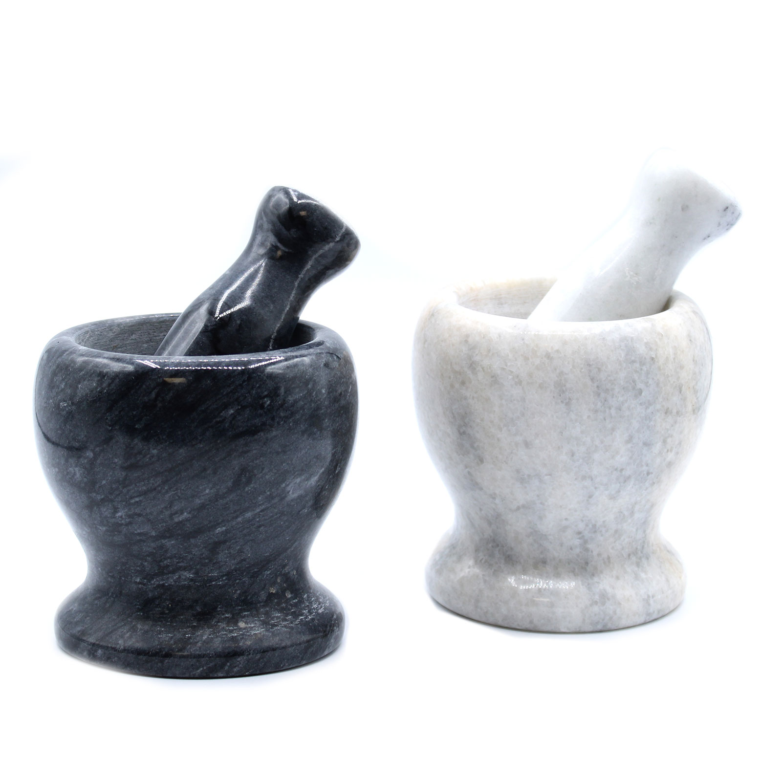 two marble pestle and mortar sets